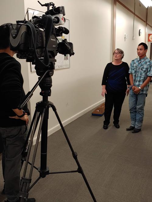 Local media interviewing UNT student